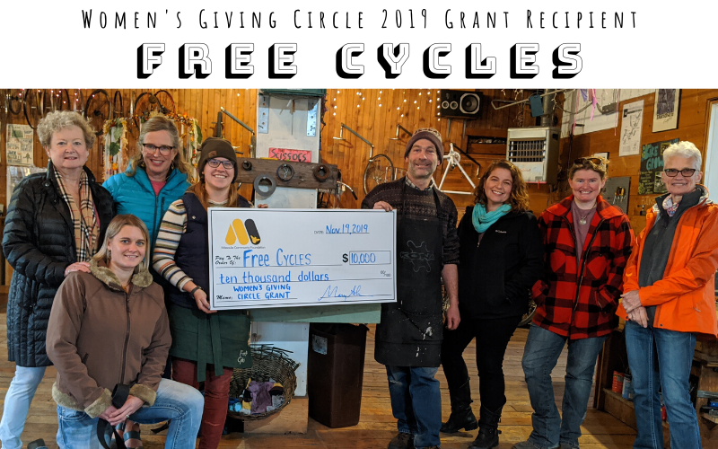 Dropping off the grant check to local nonprofit Free Cycles.